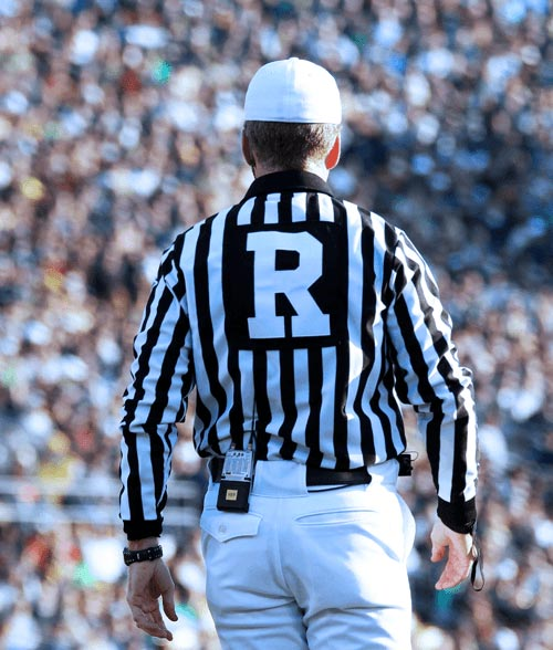 Referee at football game.